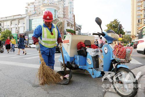 图为打扫城市的环卫工